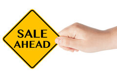 Sale Ahead traffic sign with hand Stock Photo