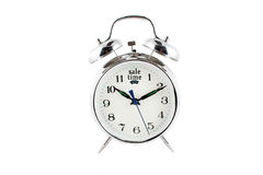Sale alarm clock. Small alarm clock isolated on a white background with sale time on the 12 Stock Photography