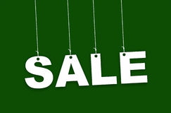 SALE alpha bits hanging with green background Royalty Free Stock Photos