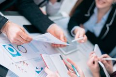 Sale analysis business meeting discussion team. Sale analysis. Business meeting. Discussion and communication. Successful team analyzing diagrams and revenue stock photo