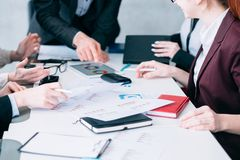 Sale analysis business meeting successful team. Sale analysis. Business meeting. Successful team analyzing diagrams. Teamlead pointing at documents stock photo