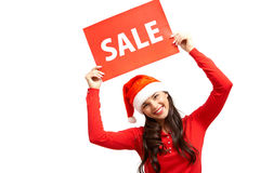 Sale announcement. Cheerful girl in Santa cap announcing sale royalty free stock photography