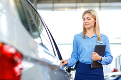 Sale assistant showing the car Stock Photography