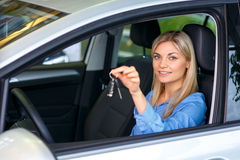 Sale assistant showing the car Royalty Free Stock Photos
