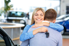 Sale assistant showing the car Stock Images