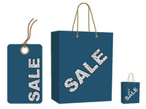 Sale bag and tag set. Blue sale bag and tag set isolated on white royalty free illustration