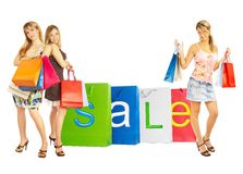 Sale - Bags girls. Three girls with bags. Comparison shopping. Sale Stock Photos