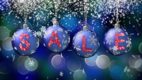 Sale banner on blue Christmas balls with round snow flake on bokeh background. 4K stock video