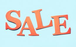 Sale banner. Colourful craft banner for marketing special discou. Nt prices or campaign offer. Letters cut from cardboard paper on a light blue background. Hand Royalty Free Stock Photos