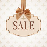 Sale banner with golden ribbon and a bow. Vintage, classic background. Vector illustration Royalty Free Stock Photography