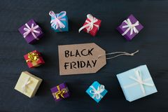 Sale banner with text word Black Friday and multicolored gift boxes royalty free stock images