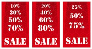 Sale banners. With different percentage degrees made to pay attention of a customers in a shop or market. White lettering on red, ornamented background Stock Photography