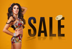 Sale. beautiful young brunette woman in a swimsuit Royalty Free Stock Photo