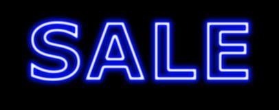 Sale blue sign neon on black Royalty Free Stock Photography