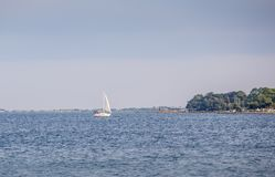 Sale  Boat on  Choctawhatchee Bay in Ft.  Walton Beach, Florida. Sailboat  in Choctawhatchee Bay in Ft. Walton Beach, Florida in the wake of Hurricane Irma Stock Image