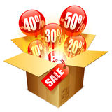 Sale box. Cardboard box with sale tag and balloons Stock Photo