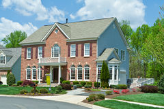 Sale Brick Single Family House Home Suburban USA. Tidy colonial style single family house for sale in suburban, Maryland, United States.  House has for sale sign Stock Photo