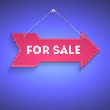 For sale, bright arrow hanging on the wall Stock Image