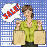 Sale bubble pop art woman with shopping bags. Vector illustration Royalty Free Stock Photos