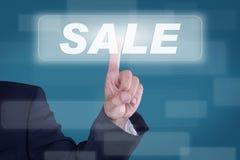 Sale. Business man pressing shopping cart icon Stock Photos