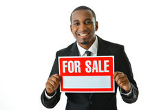 For Sale. Businessman holding up a For Sale sign Royalty Free Stock Photos
