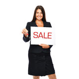 Sale. Businesswoman holding sale sign and keys.  Isolated on a white background Royalty Free Stock Photo