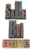 Sale, buy and trade. Collage of isolated words in vintage wood letterpress printing blocks Stock Photography