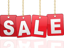 Sale cards hanging from chains Royalty Free Stock Images