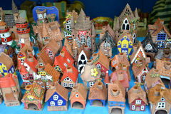 Sale of ceramic candlesticks in the form of ancient lodges at fa Stock Photos