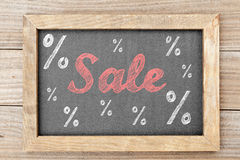 Sale chalk writing with percentage signs on chalkboard Royalty Free Stock Image