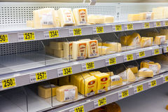 Sale of cheese in the hypermarket Auchan Royalty Free Stock Image