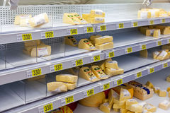 Sale of cheese in the hypermarket Auchan Stock Images