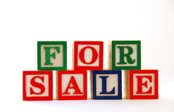 For Sale: Children's Blocks. The words For Sale spelled with children's building blocks Royalty Free Stock Photos