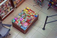 Sale of children's books in supermarket. Top view