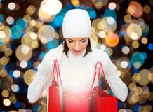 Woman in winter hat with christmas shopping bags Royalty Free Stock Images