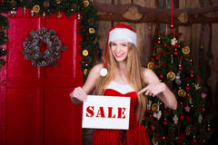 Sale, christmas, holidays and people concept - Stock Photo