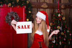 Sale, christmas, holidays and people concept - Royalty Free Stock Image