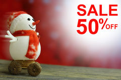 Sale 50% Christmas Snowman on bokeh background.