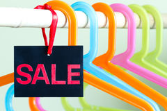 Sale of clothing concept with empty hangers Royalty Free Stock Photos