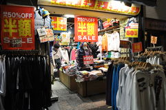 Sale. A clothing store in Asia with sale signs on display stock images