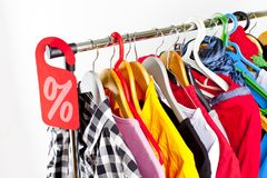 Sale in a clothing store - discount sign at a clothes rack. Sale in a clothing store - discount sign at a clothes rack royalty free stock photo