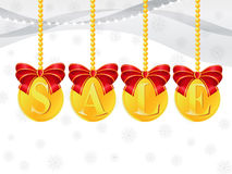 Sale coins. Christmas decorations in the form of gold coins with the inscription sale Stock Photos
