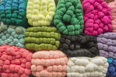 Sale of colored skeins of wool yarn in bales Royalty Free Stock Images
