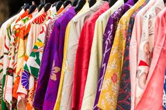 Sale of colorful kimonos on the city street in Kyoto, Japan. Close-up. stock images