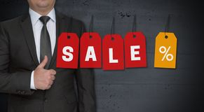 Sale concept and businessman with thumbs up stock photos