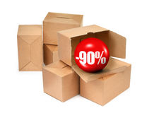 Sale concept - cardboard boxes and 3D sale ball Royalty Free Stock Images