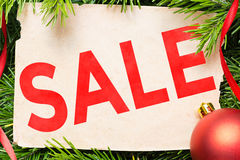 Sale concept. Christmas decoration and vintage paper sheet Stock Photos