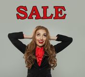Sale concept. Happy excited model with sale text portrait royalty free stock photo