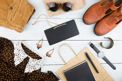 Sale concept - set of cool woman stuff and blank signboard Royalty Free Stock Image