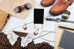 Sale concept - set of cool woman stuff and blank signboard Stock Photo